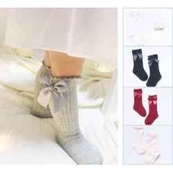 Chaussettes hautes montantes petit noeud sur sur le coté 0 à 4 ans
